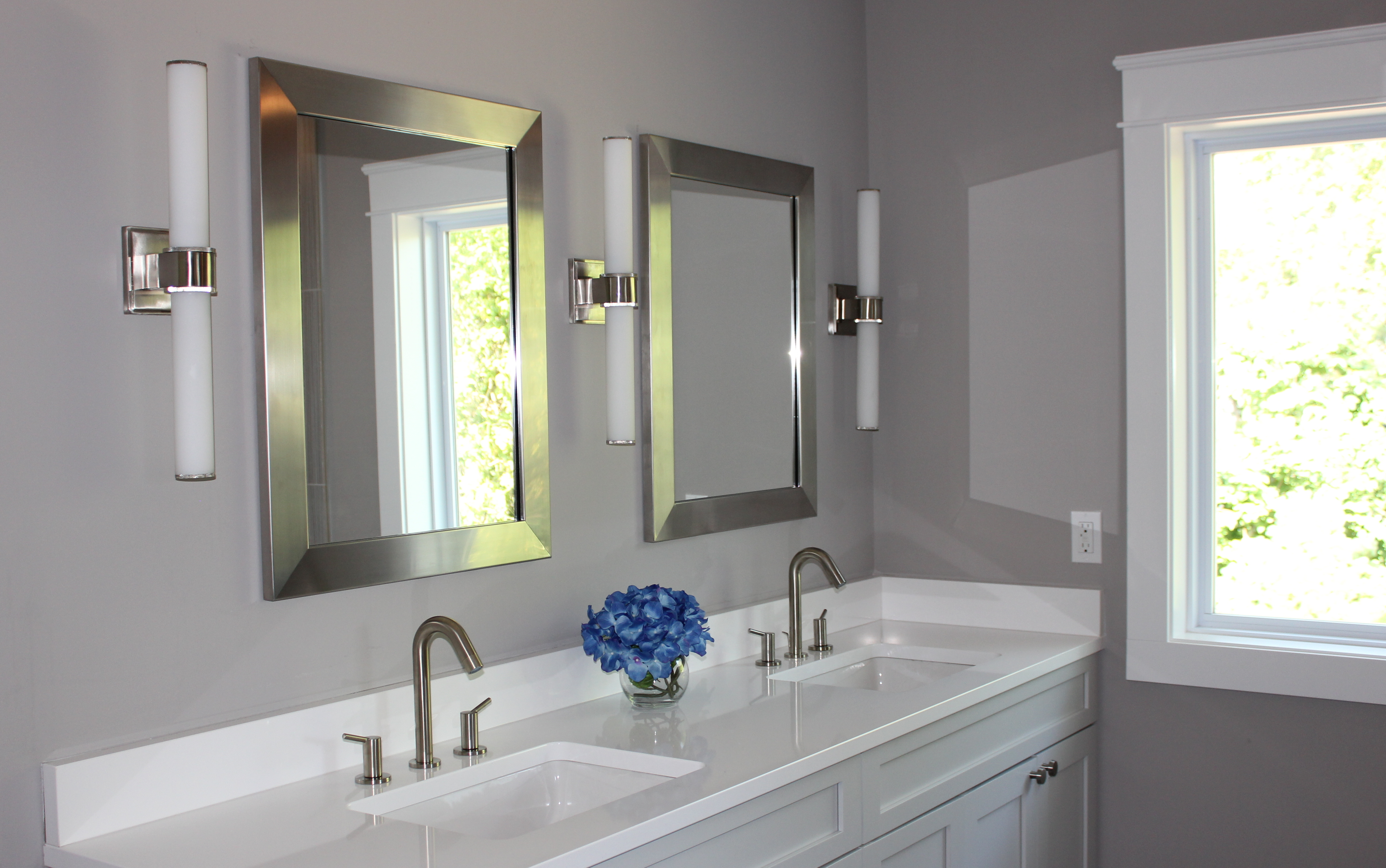 Lighting your master bath ann arbor builders for Bathroom vanity fixtures